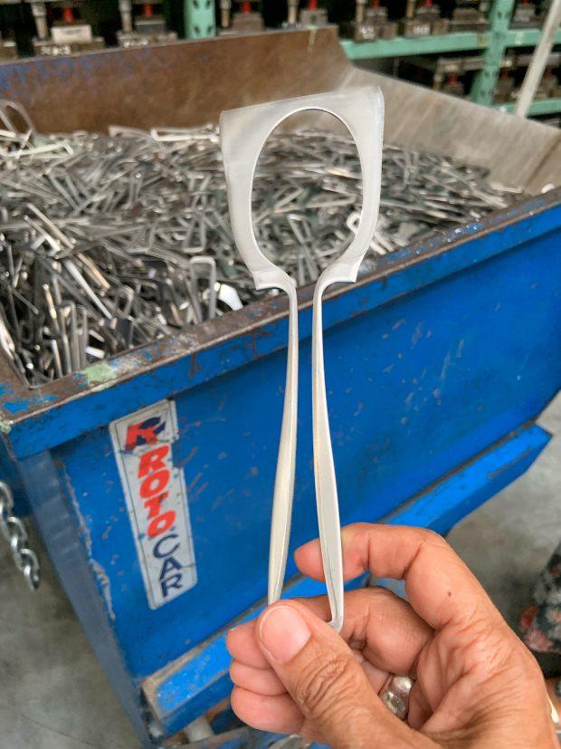 in fabbrica da Sambonet: il ritaglio di acciaio che resta dopo la nascita di un cucchiaio   © foto Sandra Longinotti